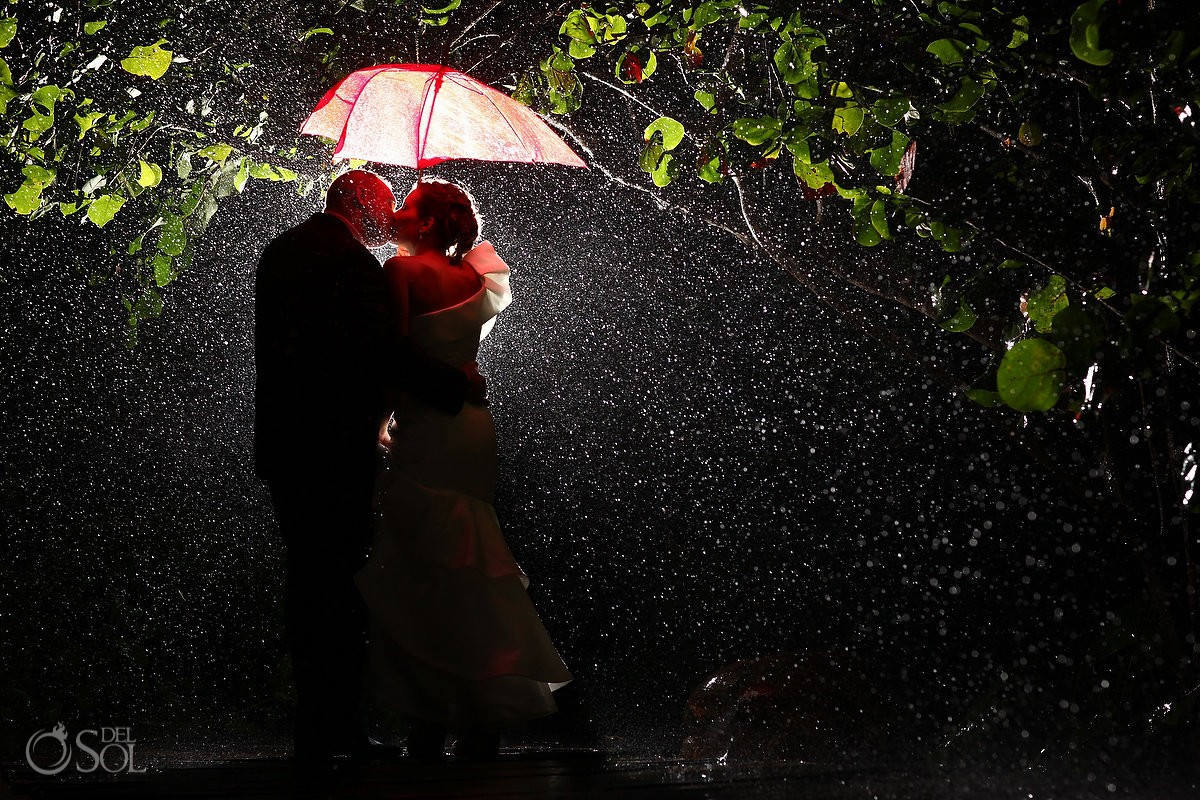 destination wedding photo with bride and groom in the rain