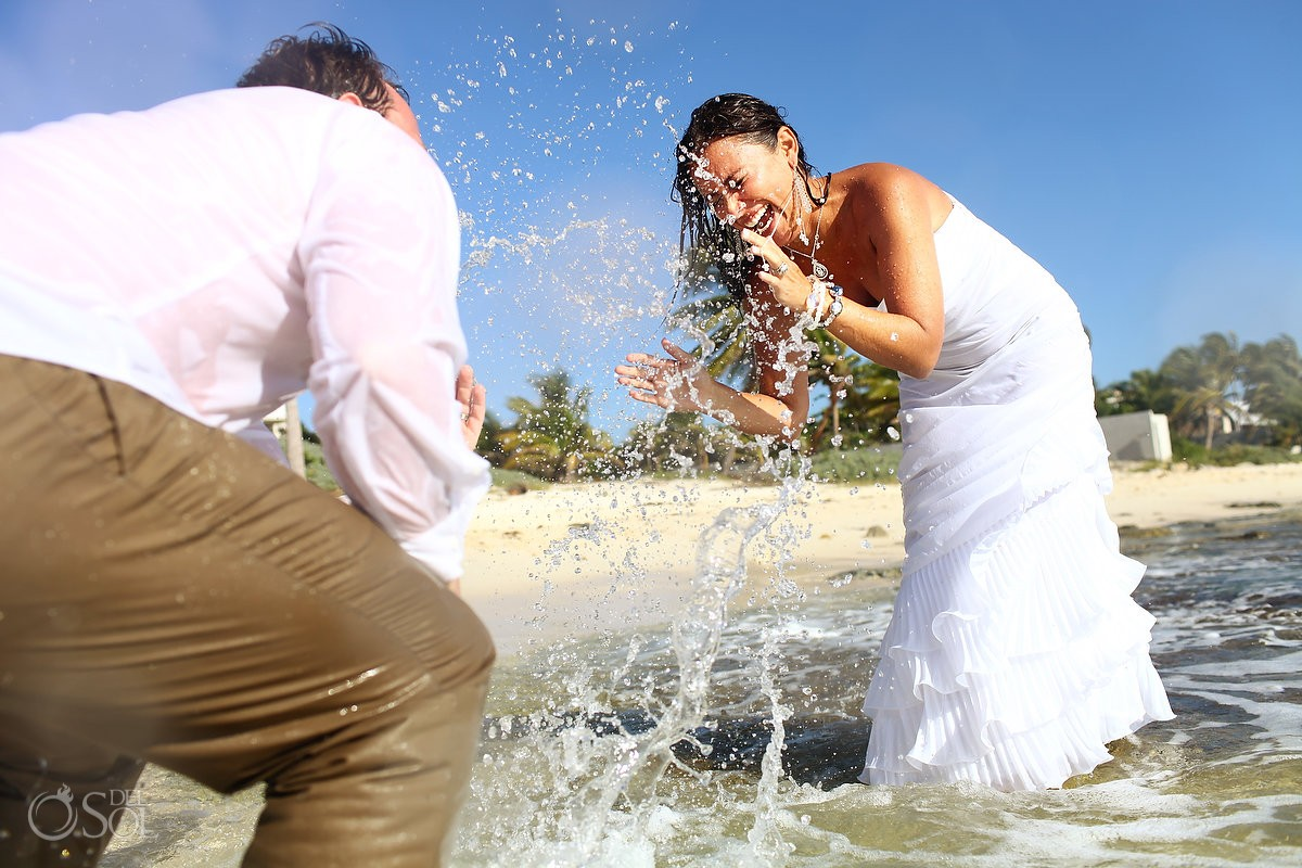 bride and groom splashing del sol photography in the huffington post weddings trash the dress
