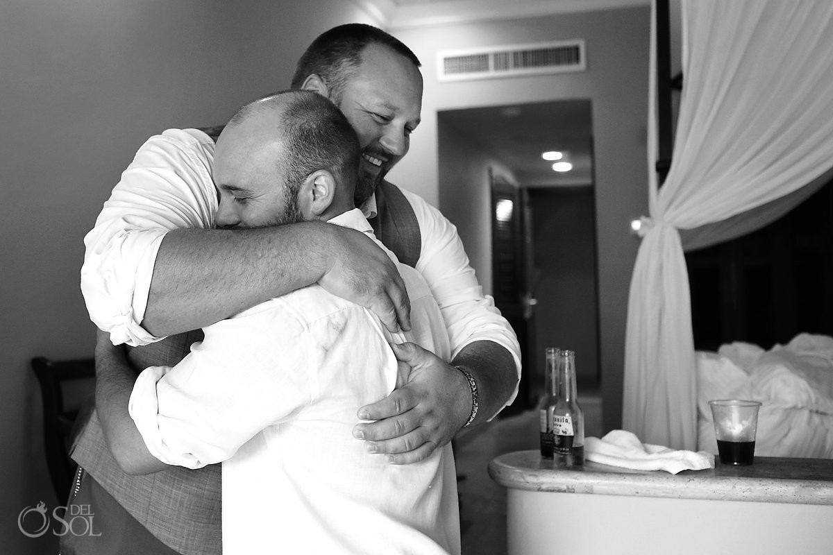 groomsmen hug getting ready for destination wedding at dreams tulum hotel