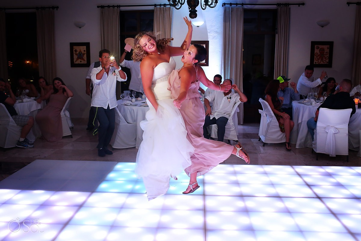bride and bridesmaids dancing at dreams tulum hotel