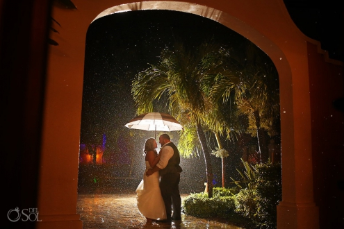bride and groom portrait in the rain at dreams tulum hotel