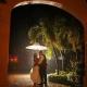 bride and groom portrait in the rain at dreams tulum hotel