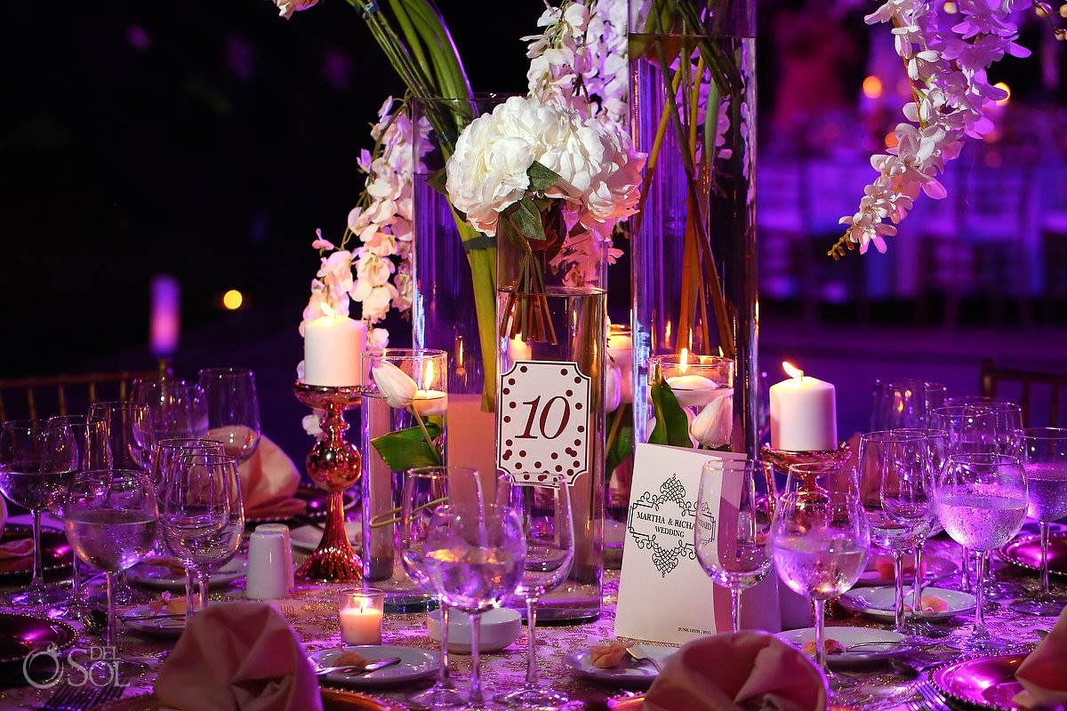 Luxurious centerpieces, flowers and table set up wedding reception at La Isla restaurant in Xcaret Park, Riviera Maya, Mexico