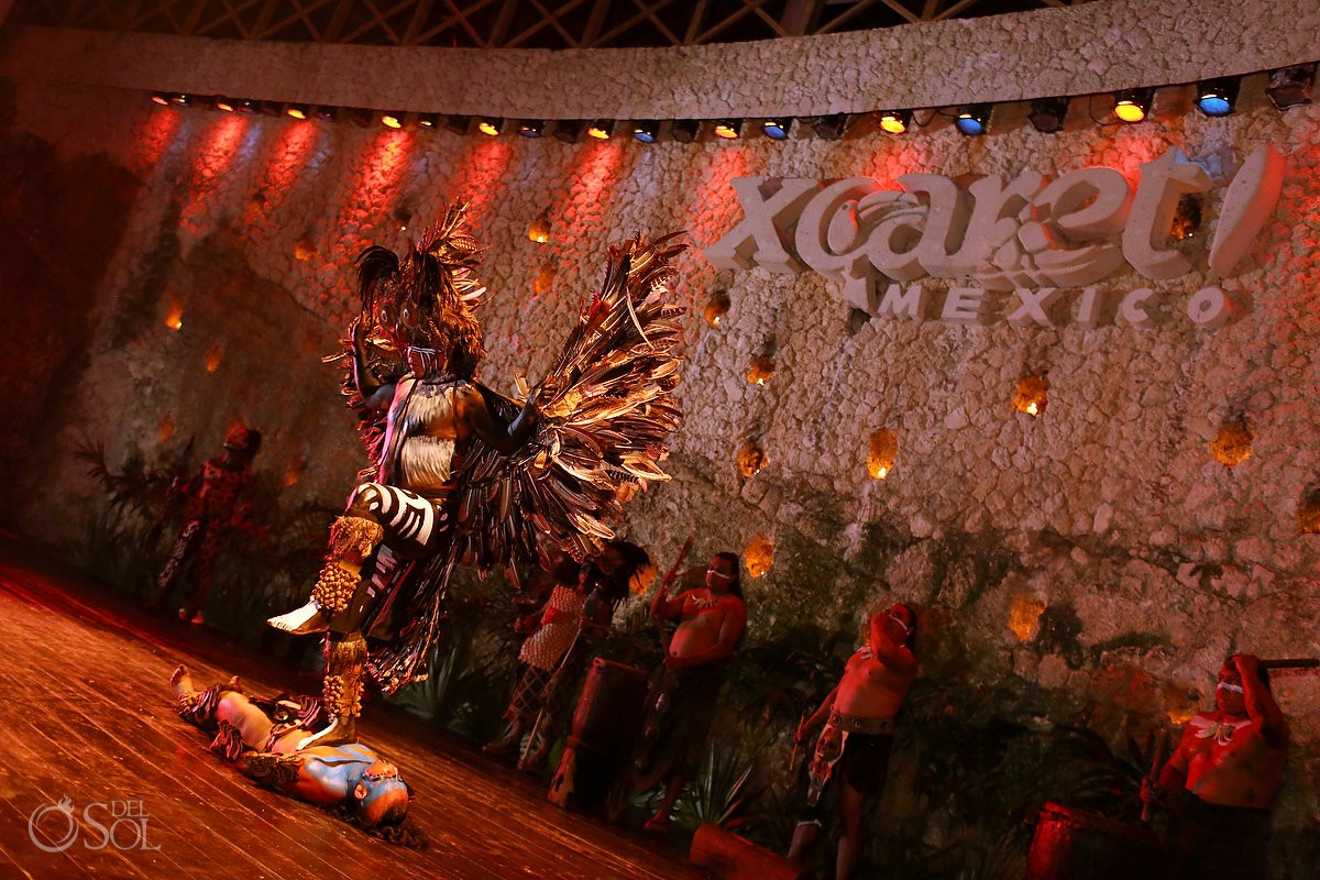 performers pre-hispanic dancers entertainment at wedding reception at La Isla restaurant in Xcaret Park, Riviera Maya, Mexico