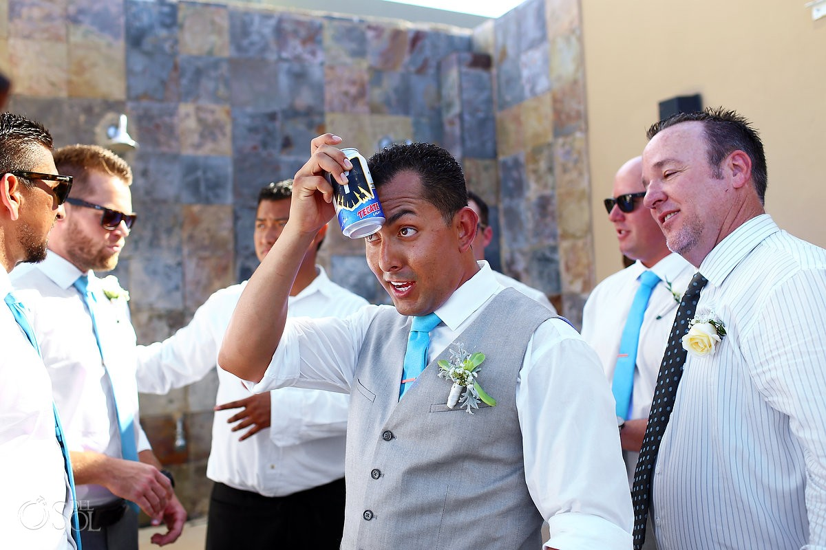 Wedding Alcohol - groomsman cooling down with a freezing can of Tecate Light