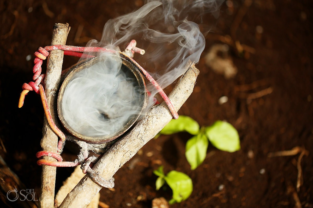 Copal smoke is used to bless the air and the people for this burial ceremony