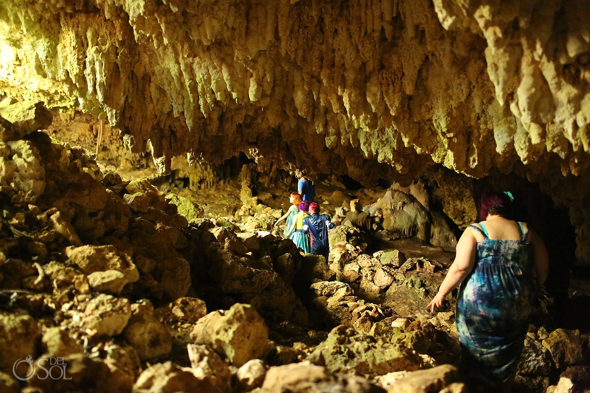 the family explores a special cenote during a burial ritual
