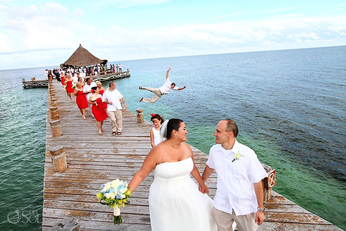 top destination beach wedding photobomb ever