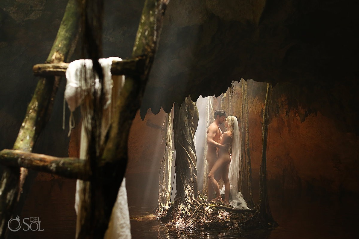 Adam and Eve totally naked bride and groom underground in a cenote mexico