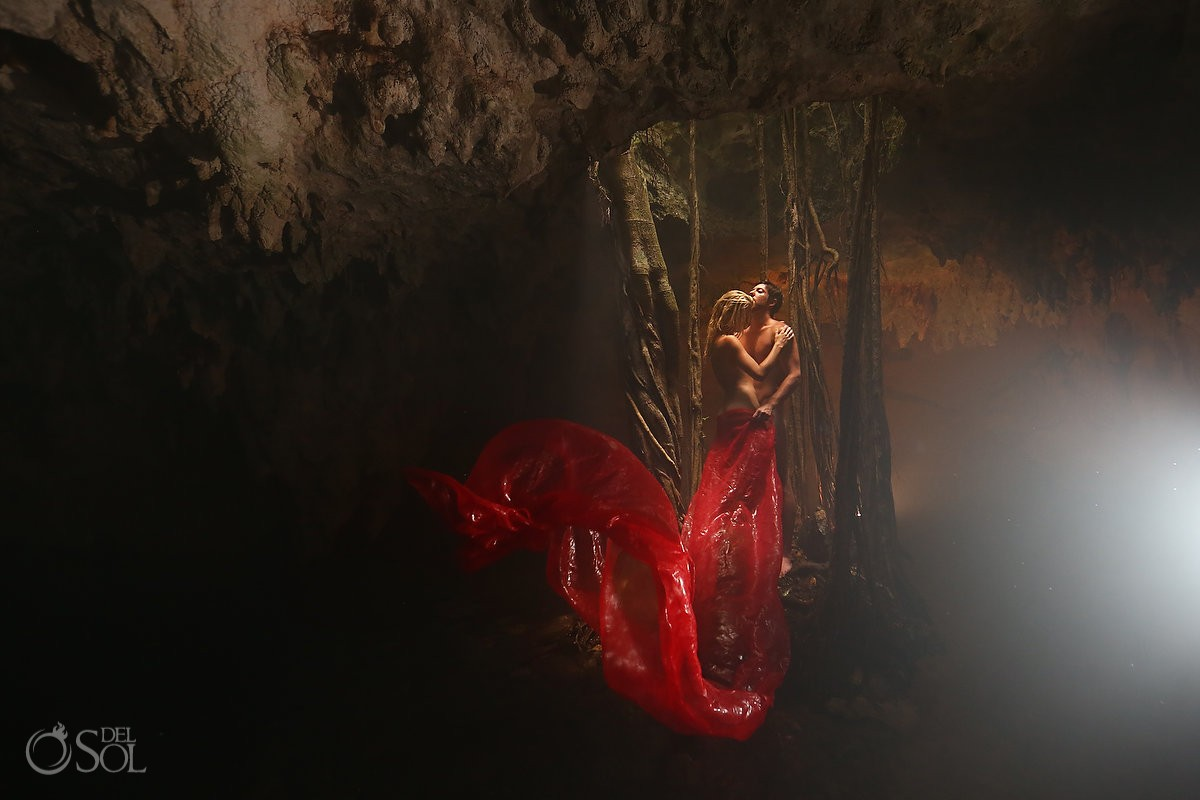 bride and groom totally naked in a cenote in mexico