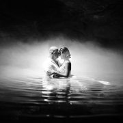 Photograph of bride and groom in a cenote cave during a mayan ceremony with epic light