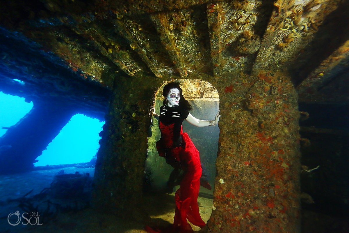 Mermaid Catrina on a shipwreck, Day of the Dead underwater fashion photography Cancun, Mexico.