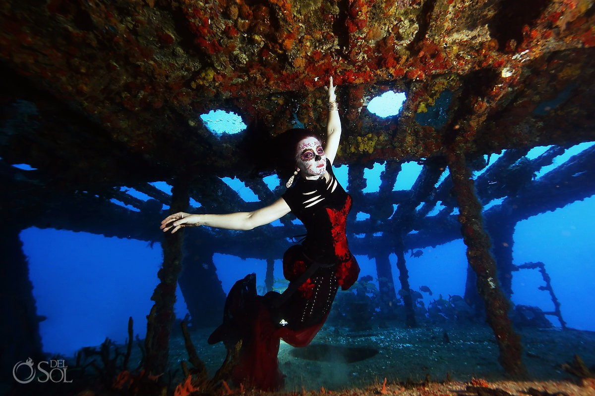 Skeleton Catrina with mermaid tail on a shipwreck Day of the Dead underwater Cancun, Mexico.
