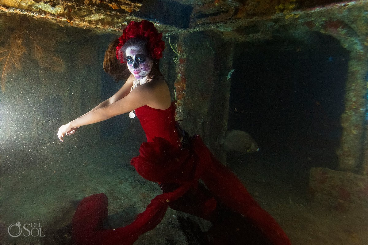 Skeleton Catrina with mermaid tail on a shipwreck Day of the Dead underwater fashion photography Cancun