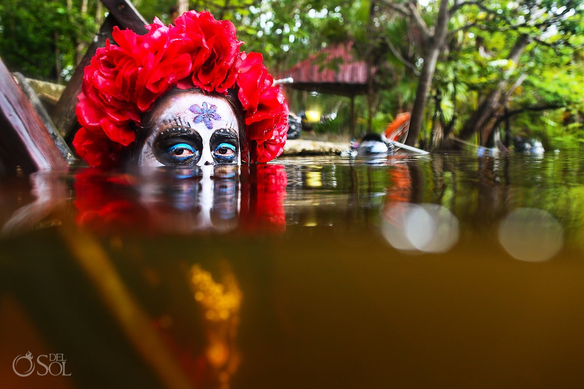 Sugar skull Skeleton Catrina makeup eyes and rose head piece crown Day of the Dead underwater fashion photography Riviera Maya, Mexico.