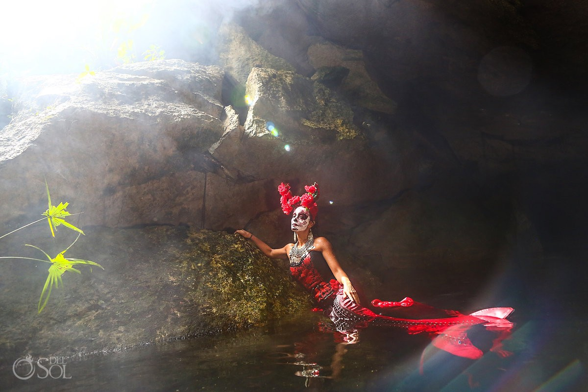 Skeleton Catrina with mermaid tail in a cenote Day of the Dead underwater