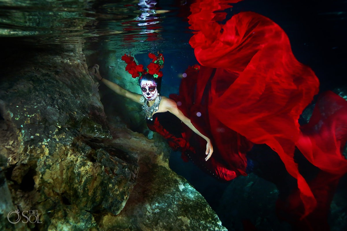 Skeleton Catrina with mermaid tail in cenote Day of the Dead underwater fashion photography
