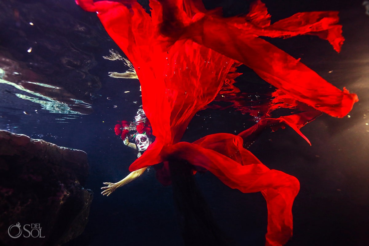 Red Mermaid Catrina in a cenote, Day of the Dead underwater creative fine art photography Cancun, Mexico.