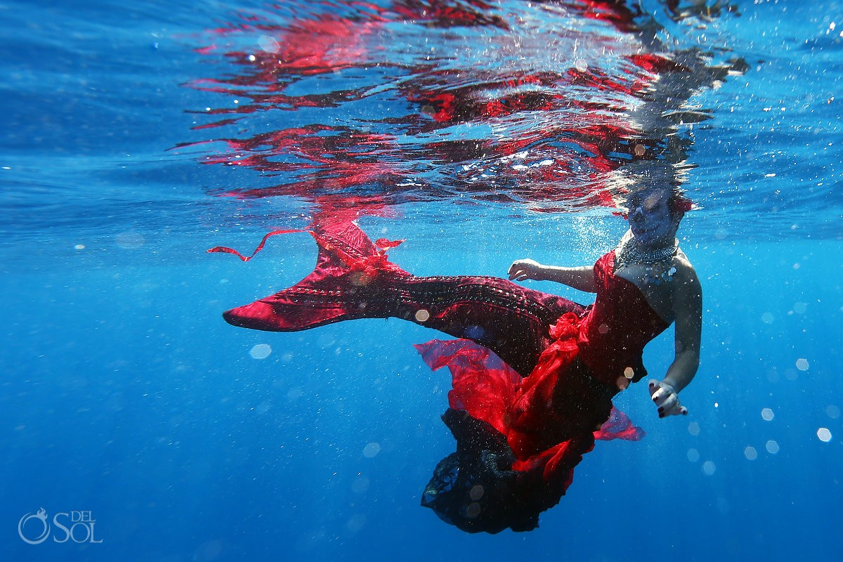 Mermaid Catrina skeleton swimming in the ocean, Day of the Dead underwater portrait photography Cancun, Mexico.