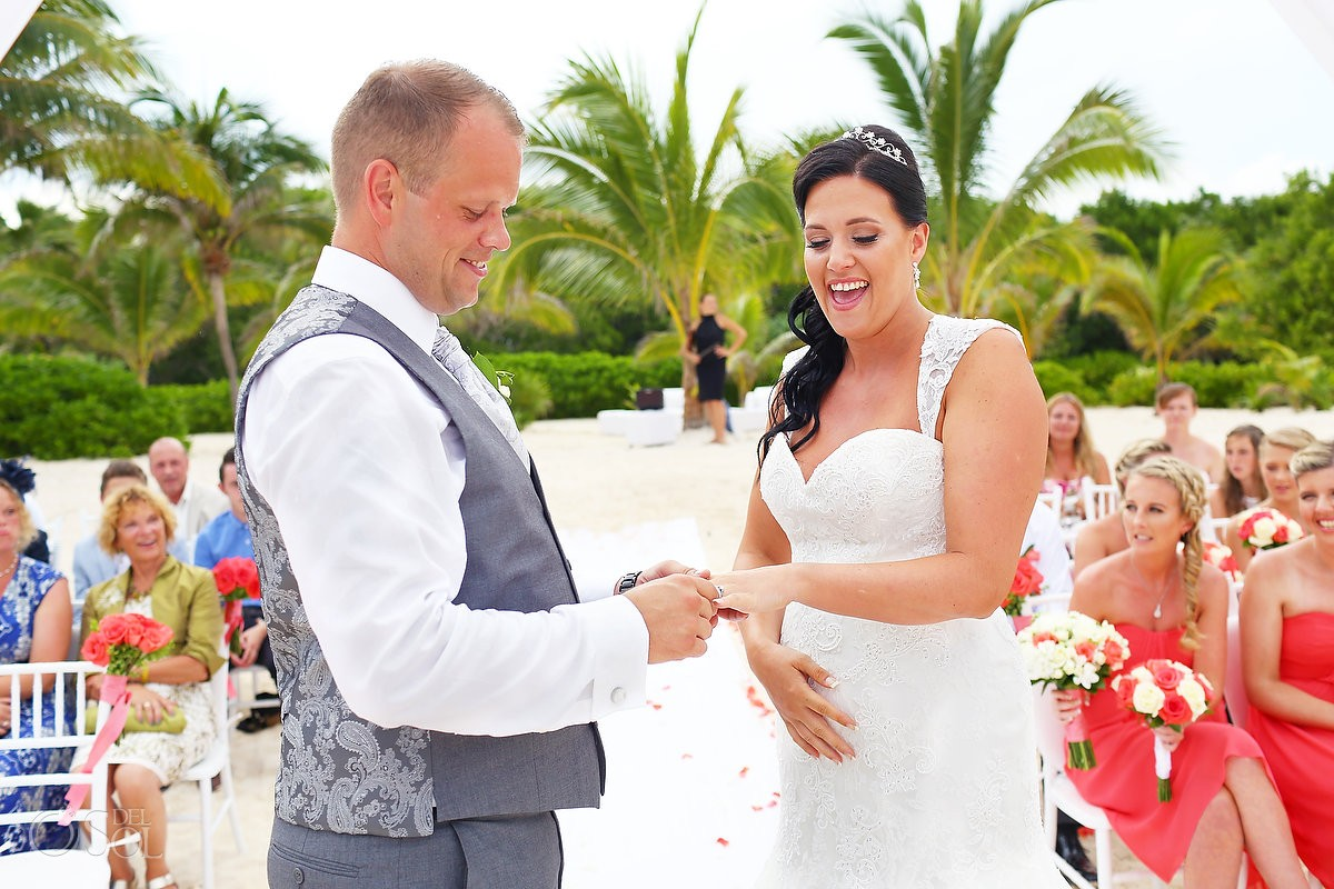 Bride and groom exchange rings Wedding at Grand Coral Beach Club