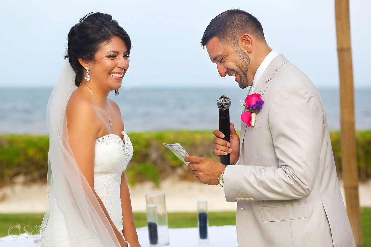 Wedding vows between bride and groom at Ocean Coral and Turquesa, Puerto Morelos destination wedding