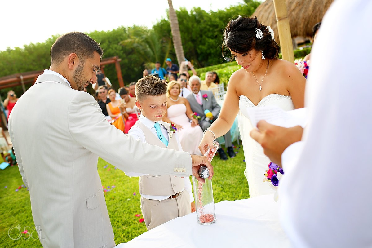Unity Sand ceremony with bride, groom and child at Ocean Coral and Turquesa, Puerto Morelos