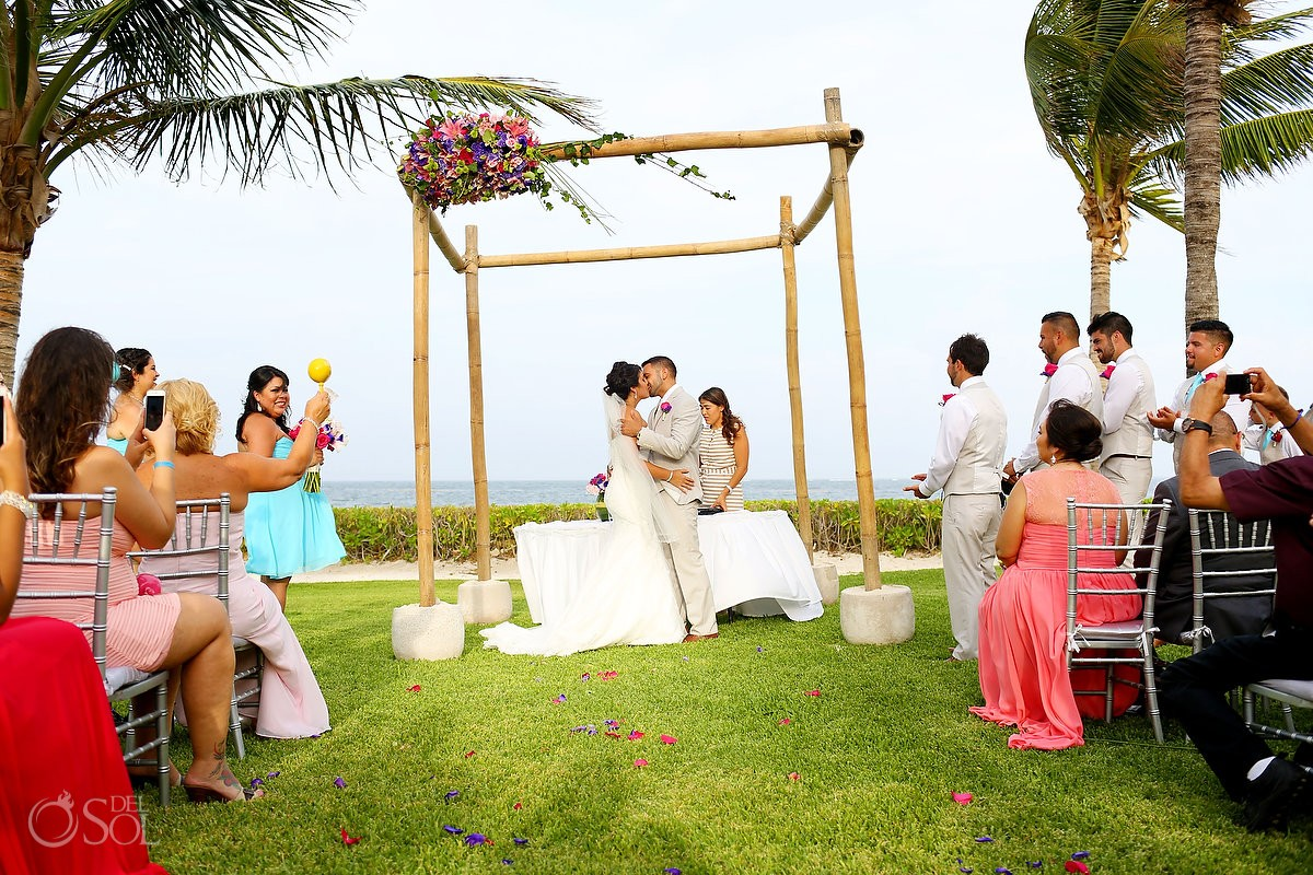 First kiss of bride and groom at Ocean Coral and Turquesa, Puerto Morelos