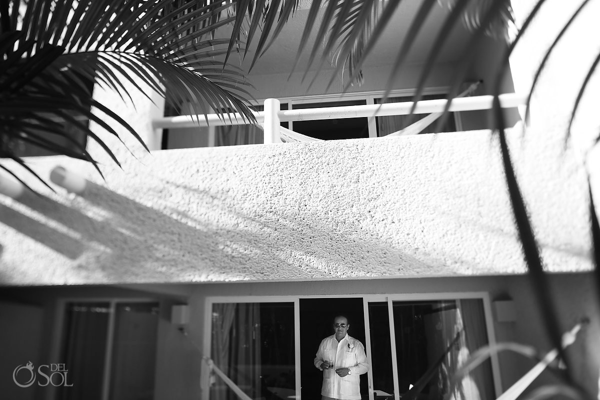 groom leaving his room at Omni Puerto Aventuras Beach Resort, Mexico.
