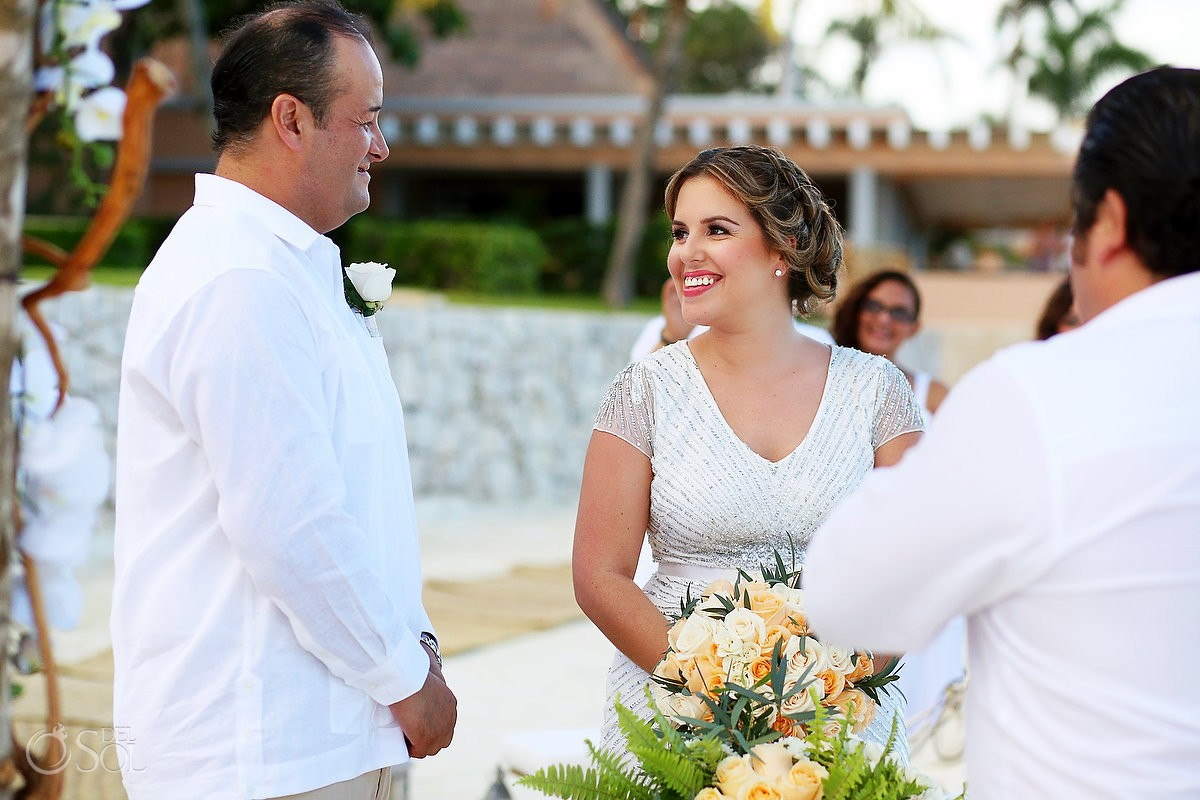 Bride and groom at the altar during a Wedding ceremony at Omni Puerto Aventuras Beach Resort, Mexico.