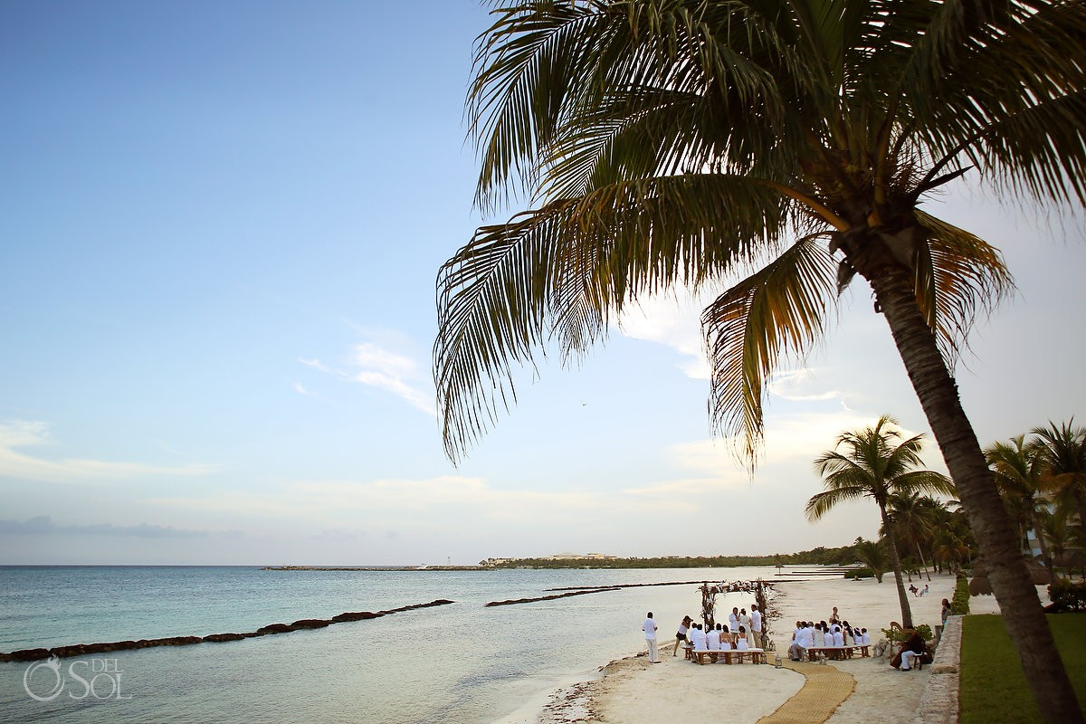 Beach Wedding ceremony with palm trees at Omni Puerto Aventuras Beach Resort, Mexico.