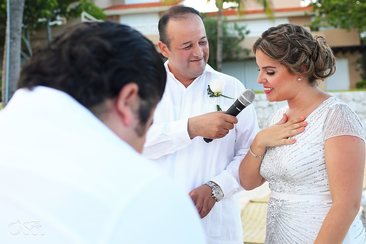 bride saying vows during the wedding ceremony at Omni Puerto Aventuras Beach Resort, Mexico.