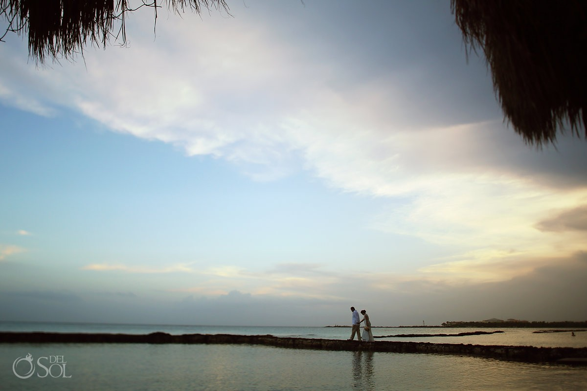 sunset bride and groom portraits, wedding ceremoy at Omni Puerto Aventuras Beach Resort, Mexico