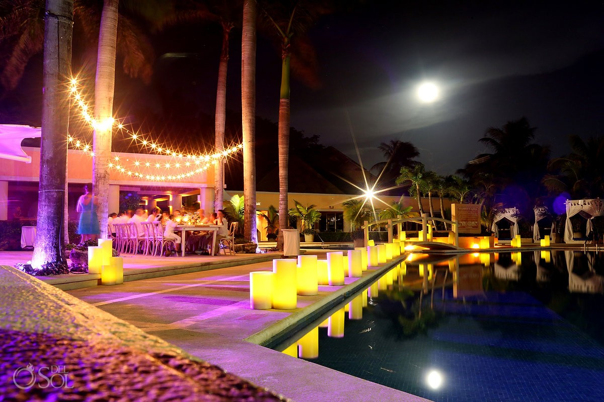 poolside wedding reception at Omni Puerto Aventuras Beach Resort, Mexico