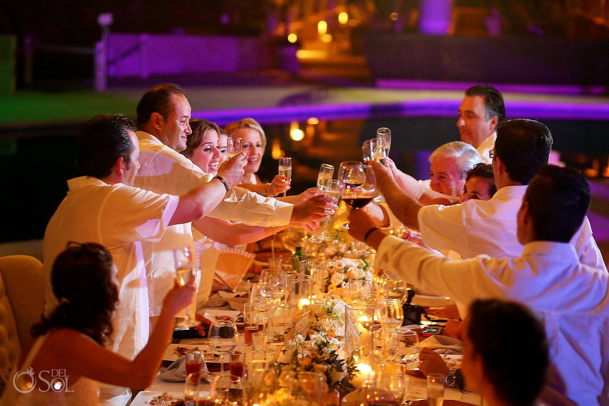 Bride and groom offering Toasts for the beach wedding reception at Omni Puerto Aventuras Beach Resort, Mexico