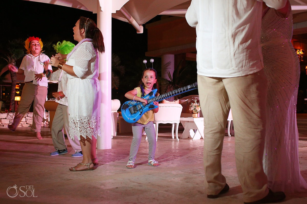 children playing toy guitars on the dance floor at Omni Puerto Aventuras Beach Resort, Mexico