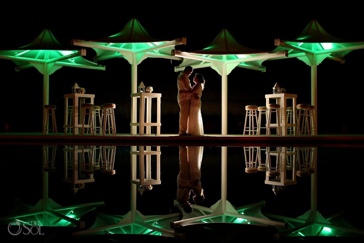 Pool reflection bride and groom portrait at Omni Puerto Aventuras Beach Resort, Mexico