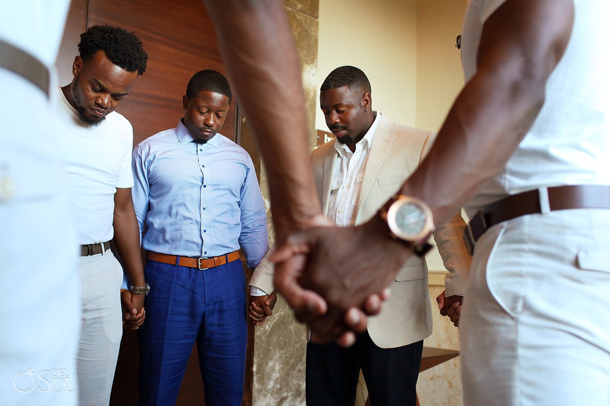 Groomsmen praying at Secrets Playa Mujeres, Cancun, Mexico