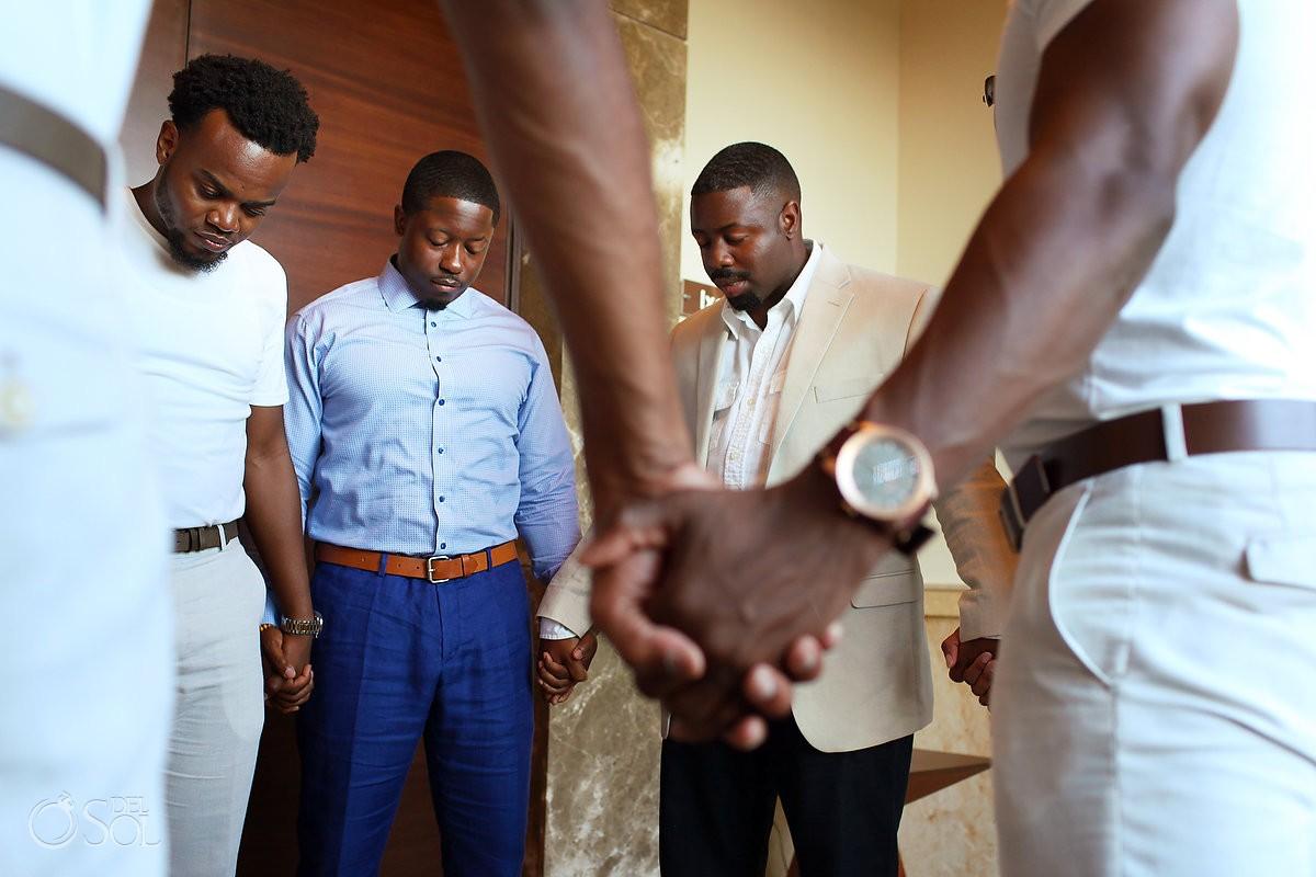 Groomsmen praying at Secrets Playa Mujeres, Cancun, Mexico
