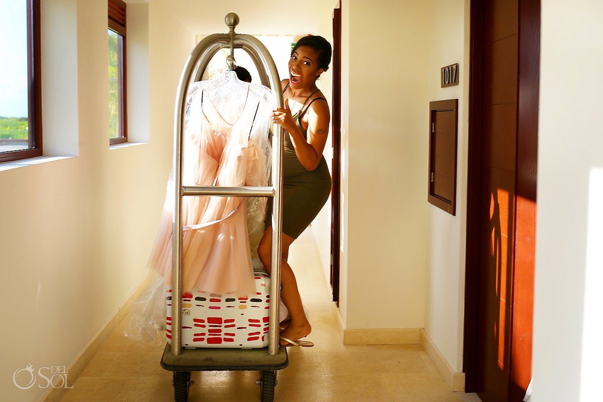 Bride on luggage cart with wedding dresses at Secrets Playa Mujeres, Cancun, Mexico