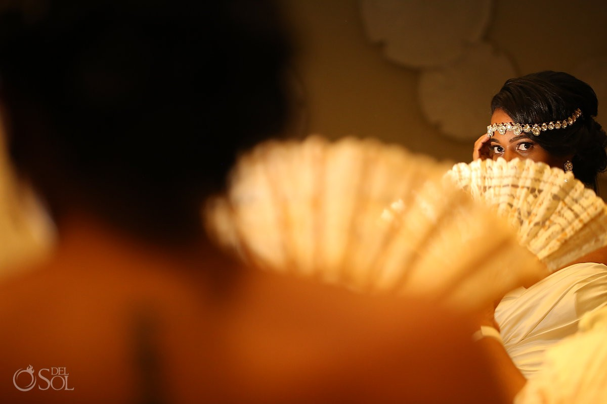 bride with bohemian crown and fan, getting ready at Secrets Playa Mujeres, Cancun, Mexico
