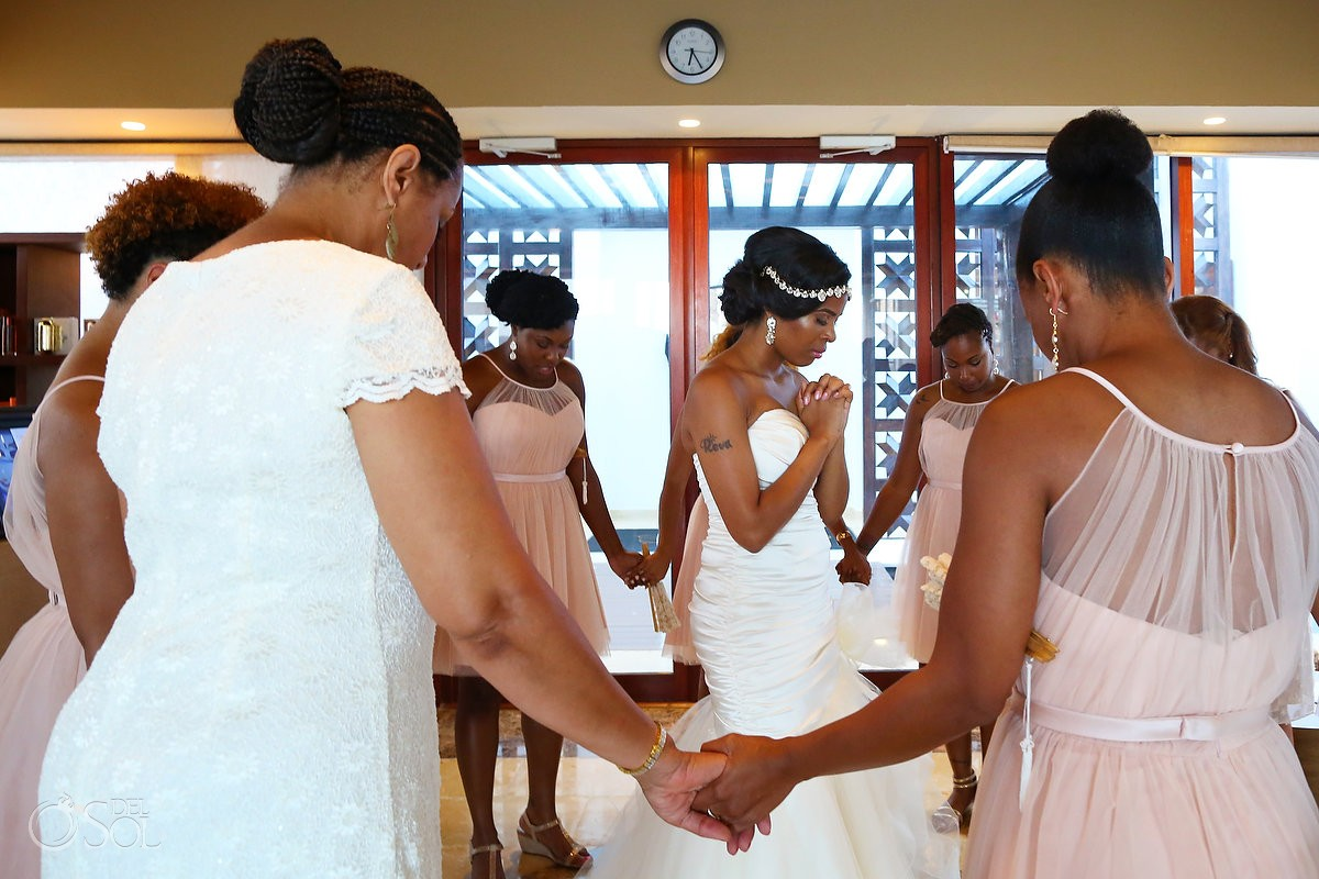bride and bridesmaids praying at Secrets Playa Mujeres, Cancun, Mexico