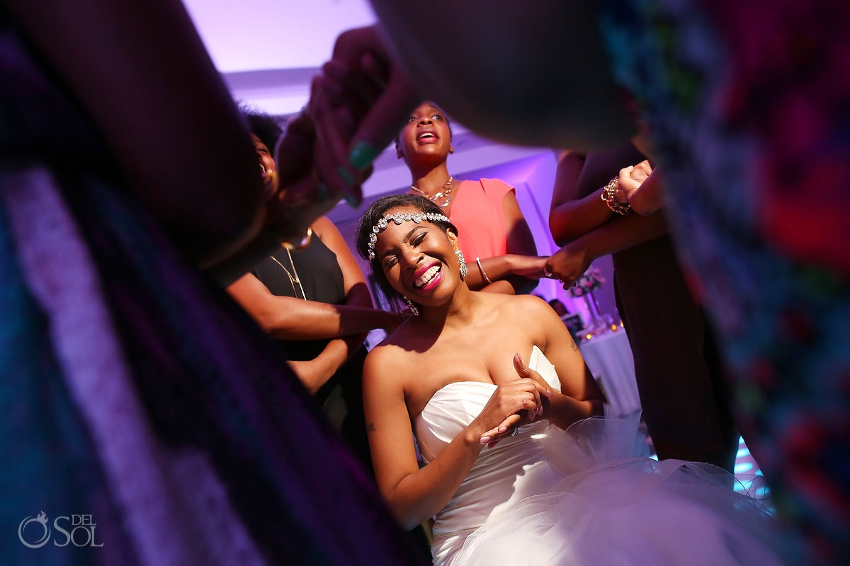 guests dance around the bride during a ballroom wedding reception at Secrets Playa Mujeres, Cancun, Mexico