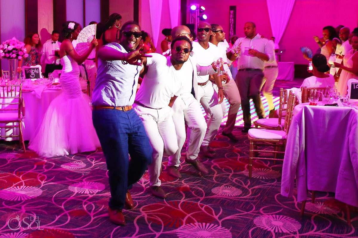 groomsmen dancing during the ballroom wedding reception at Secrets Playa Mujeres, Cancun, Mexico