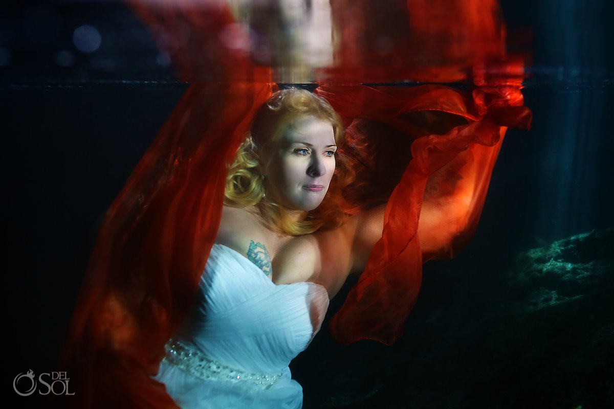 underwater wedding photography trash the dress red scarf