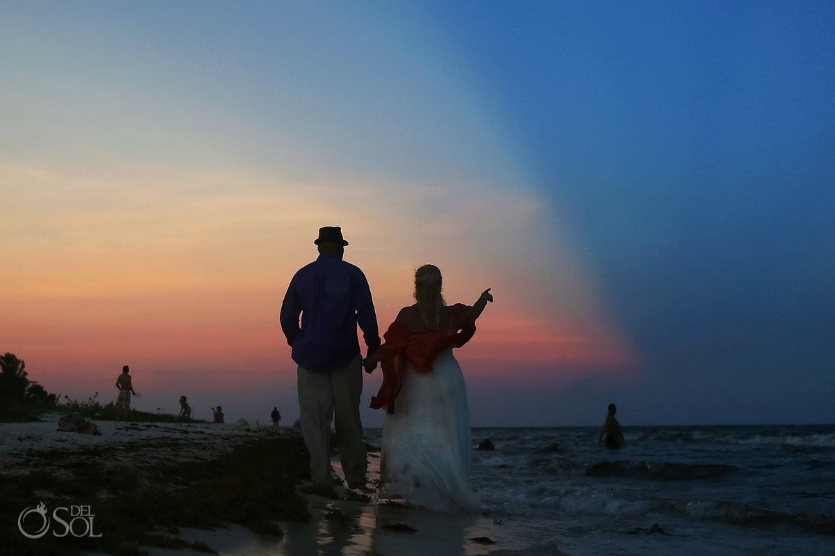 bride and groom portrait with sunset over playa del carmen
