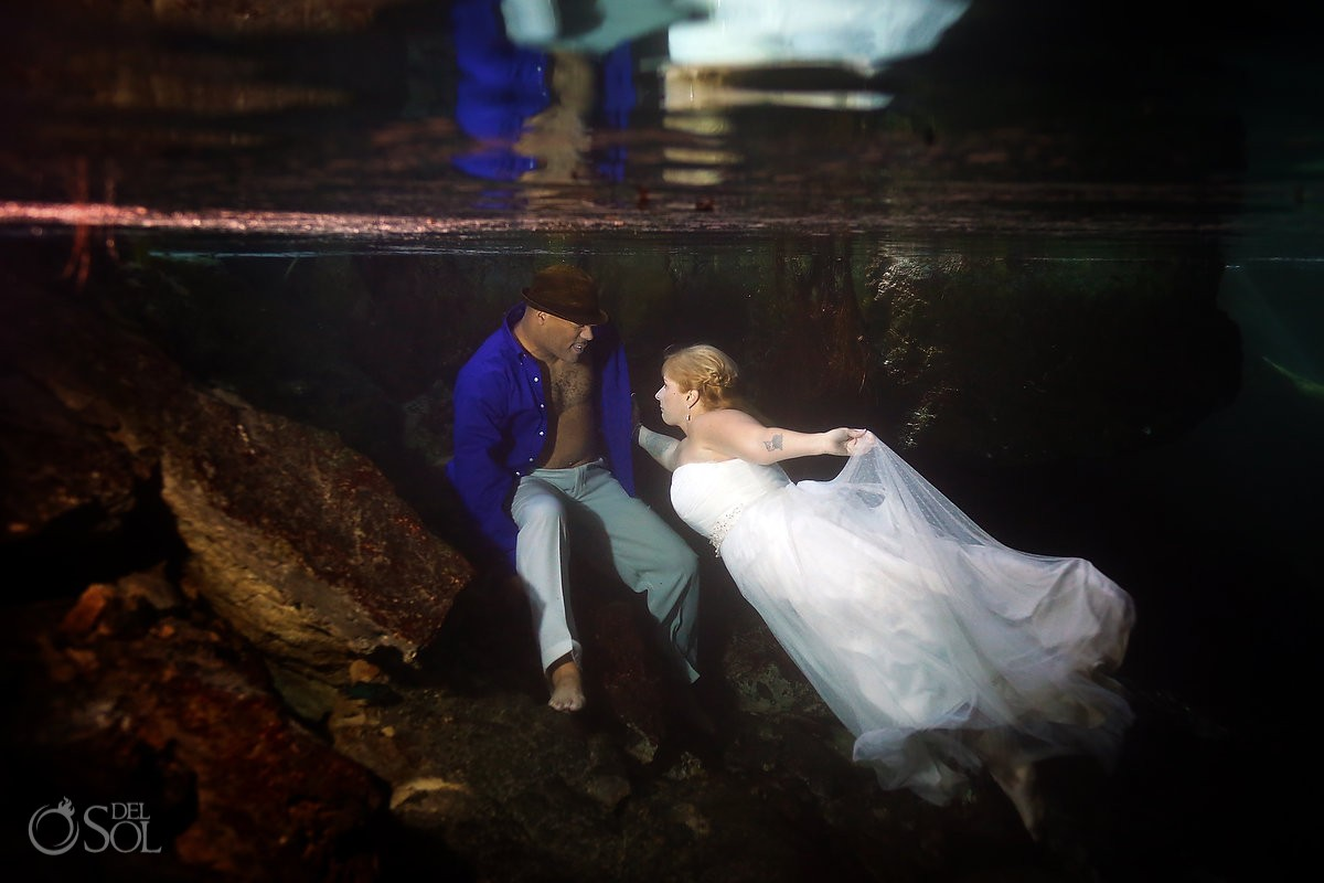 bride and groom underwater for a trash the dress session