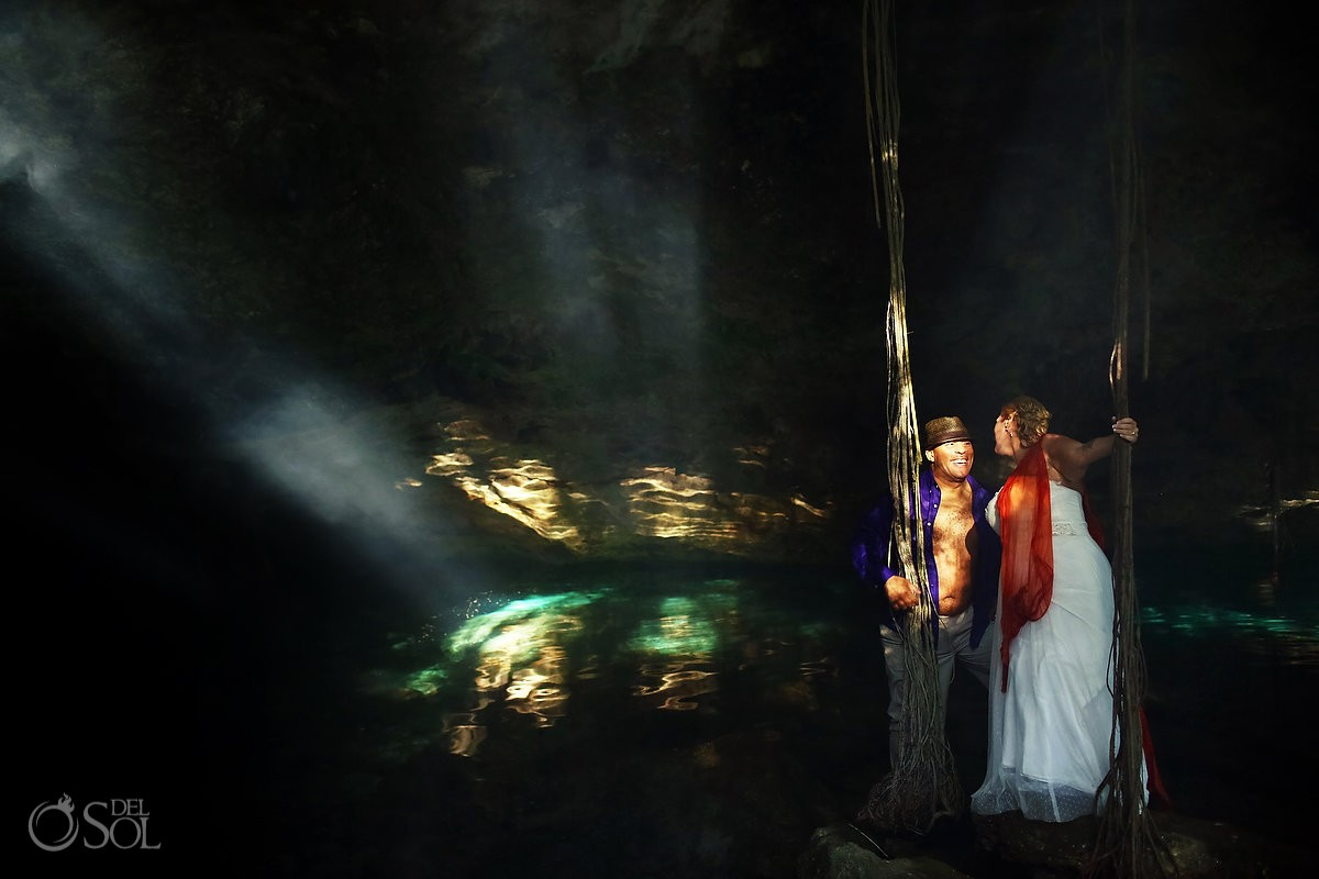 bride and groom portrait session trash the dress in a cenote