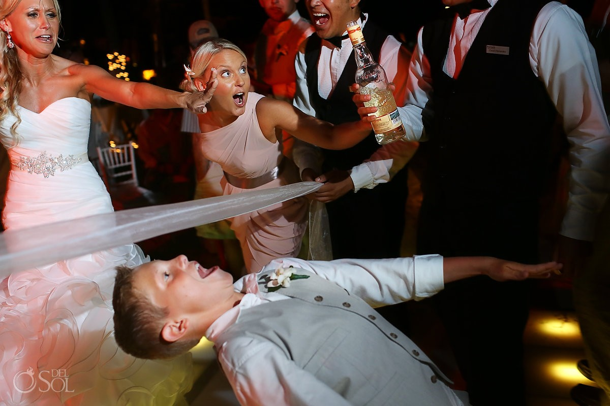 Kid doing the limbo dance during a wedding reception