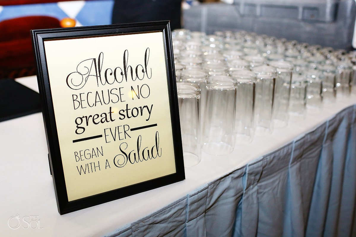 Wedding signs, alcohol, because no great story ever began with a salad.