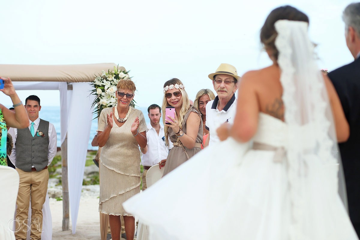 Bride enters ceremony first look crying mom beach Wedding at Grand Sirenis Riviera Maya, Mexico.